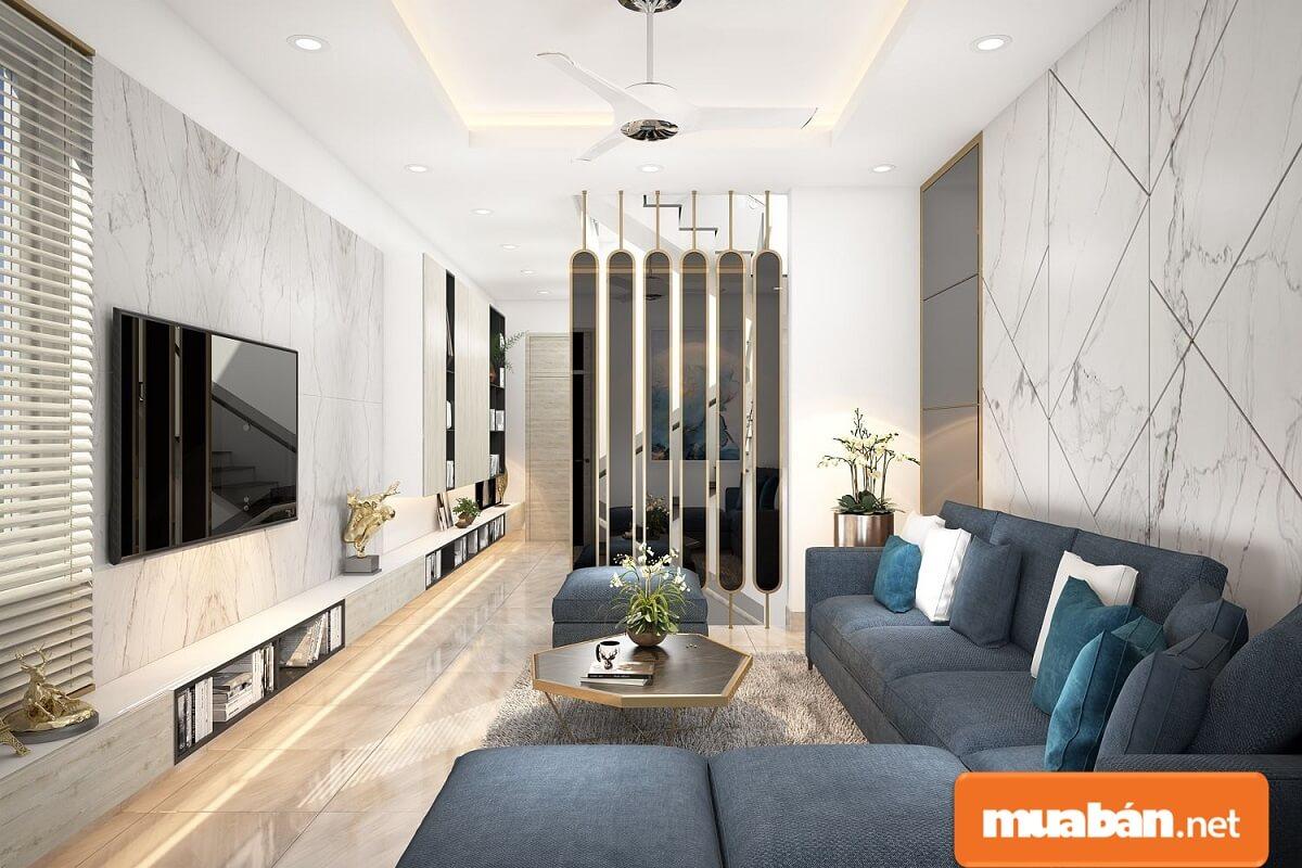 Nội thất sang chảnh, sofa hình chữ L phù hợp với diện tích nhỏ của phòng khách này.